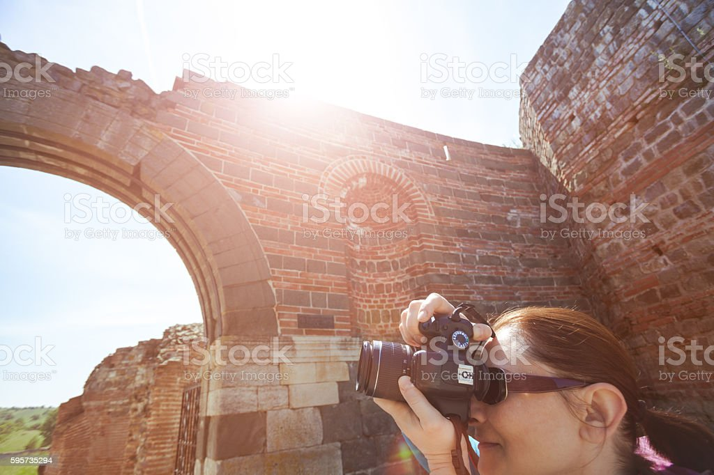 Tourist photographing historic Roman place stock photo
