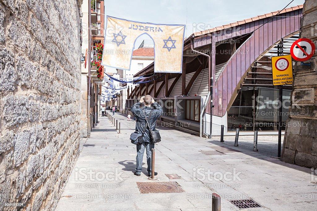Tourist photographing Jewish quarter in Vitoria-Gasteiz stock photo