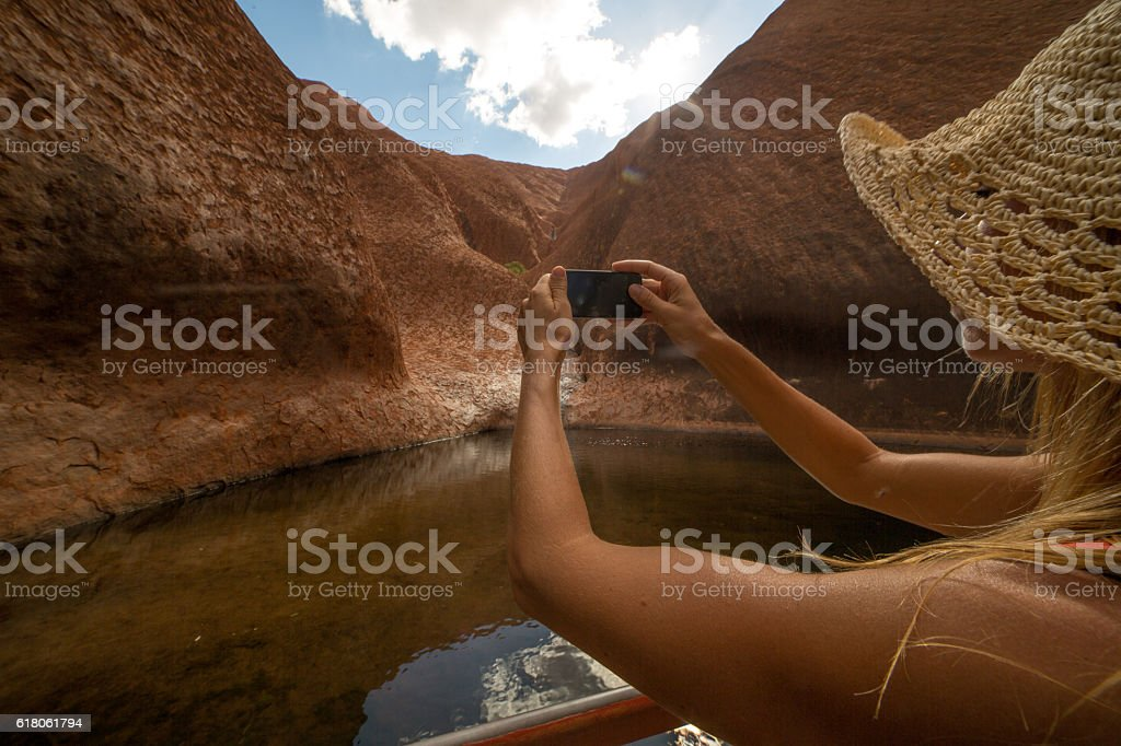 Tourist photographing landscape using mobile phone stock photo