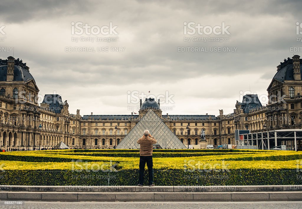 Tourist Photographing Louvre Pyramid stock photo