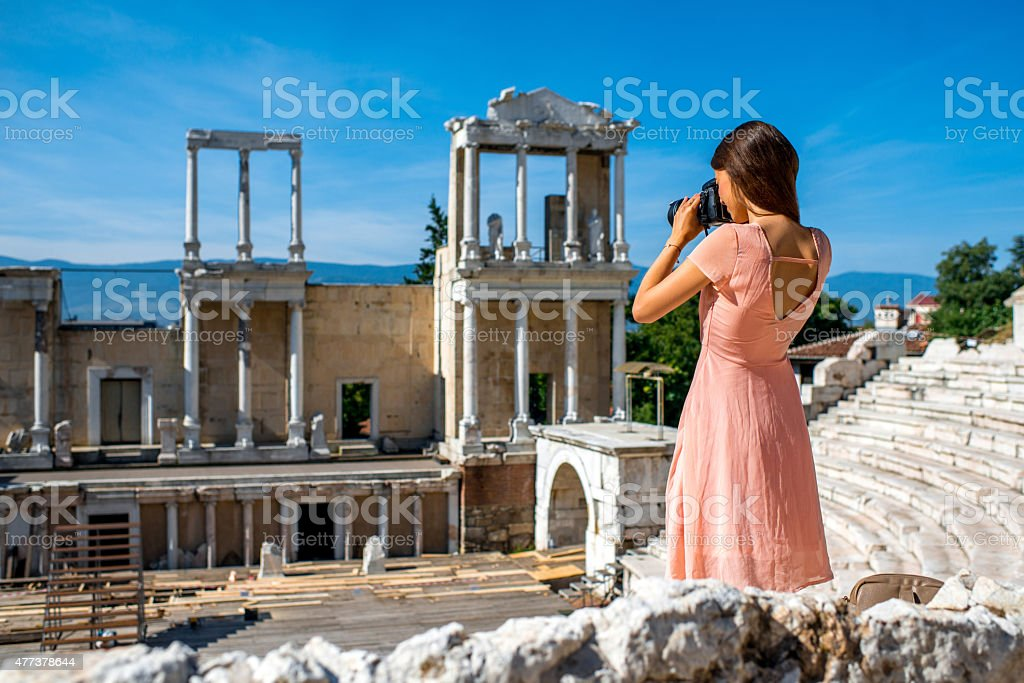Tourist photographing Roman theater in Plovdiv stock photo
