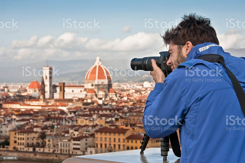 Tourist Photographing the Duomo of Firenze in Italy royalty-free stock photo