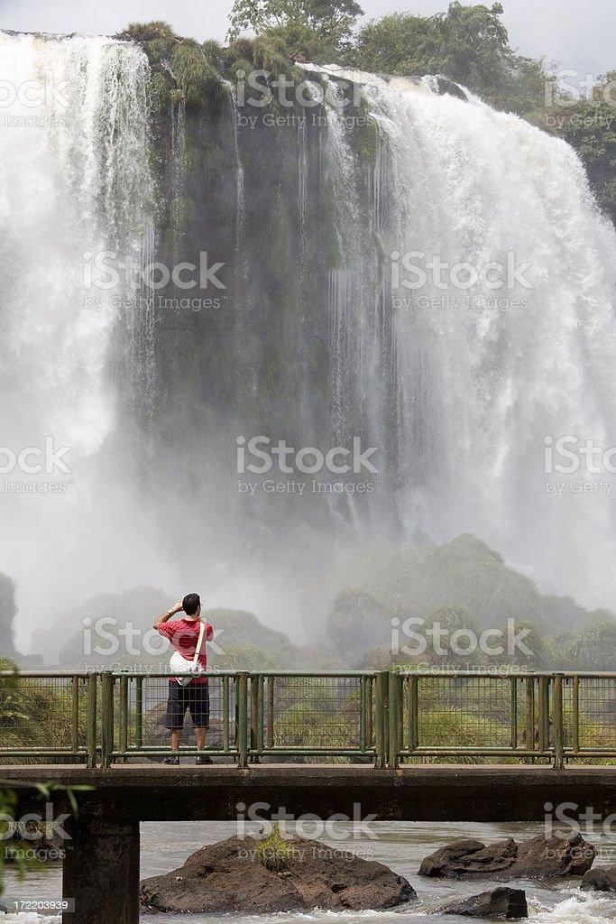 Tourist photographing the iguacu falls royalty-free stock photo