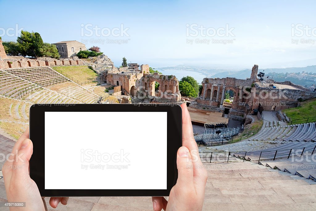 tourist photographs of Teatro Greco, Taormina stock photo