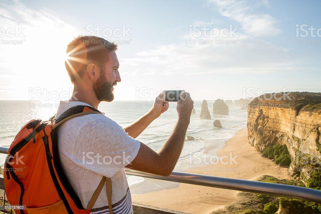 Tourist photographs the Twelve Apostles using mobile phone stock photo