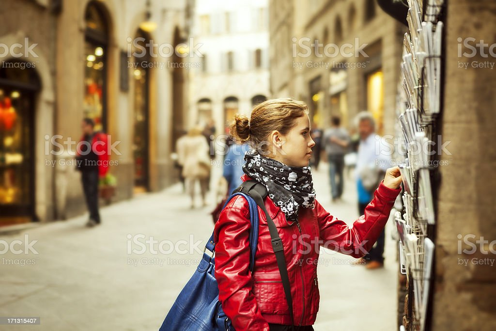 Tourist picking postcards in Siena royalty-free stock photo