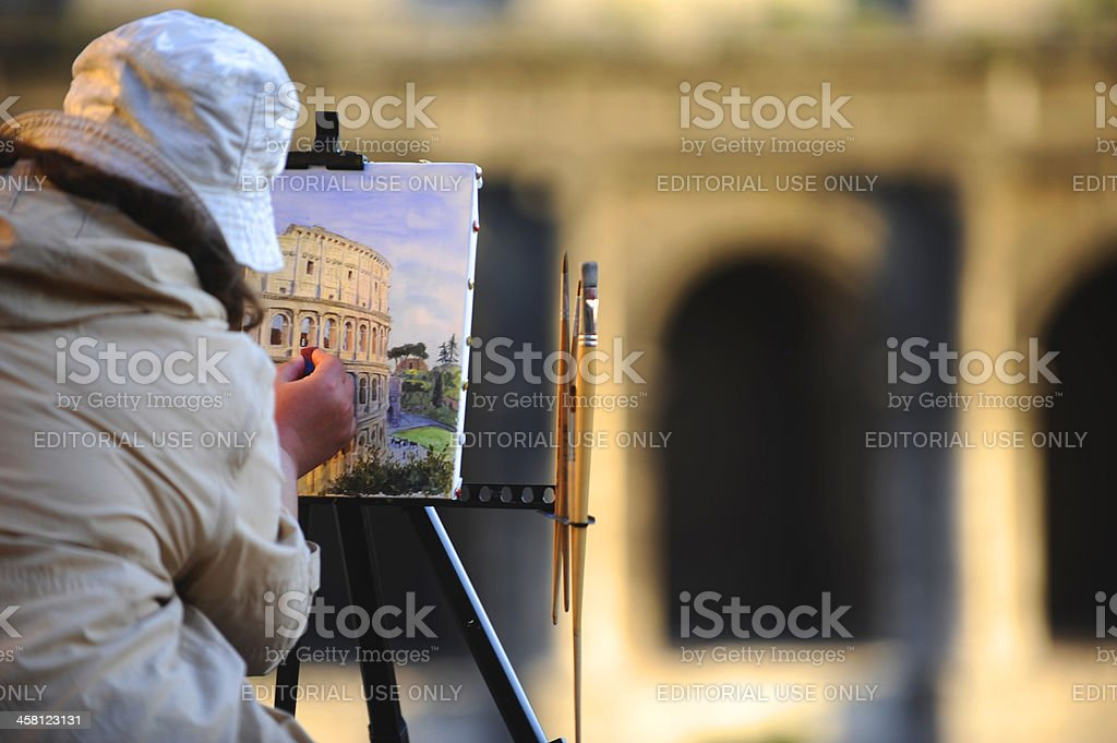 Tourist picturing Colosseum royalty-free stock photo