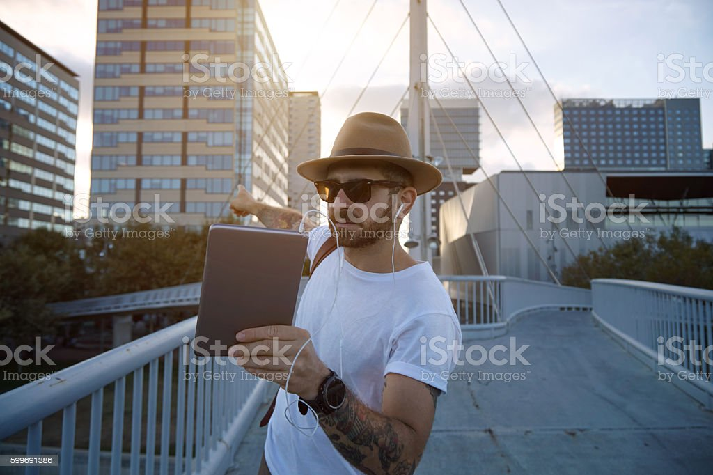 Tourist pointing at a building during  video call stock photo