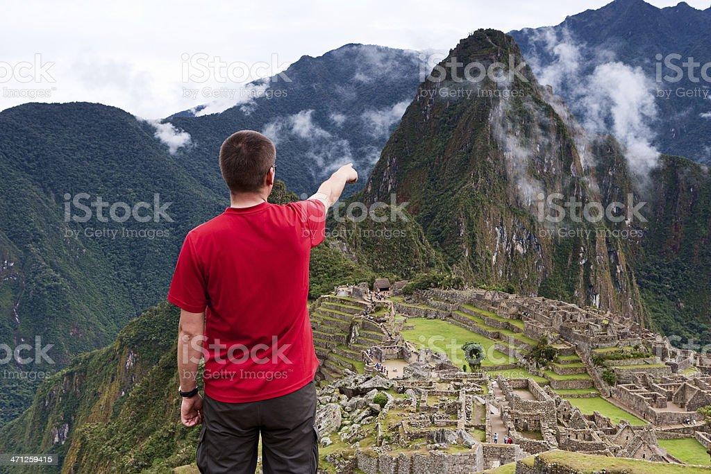 Tourist pointing at Machu Picchu royalty-free stock photo