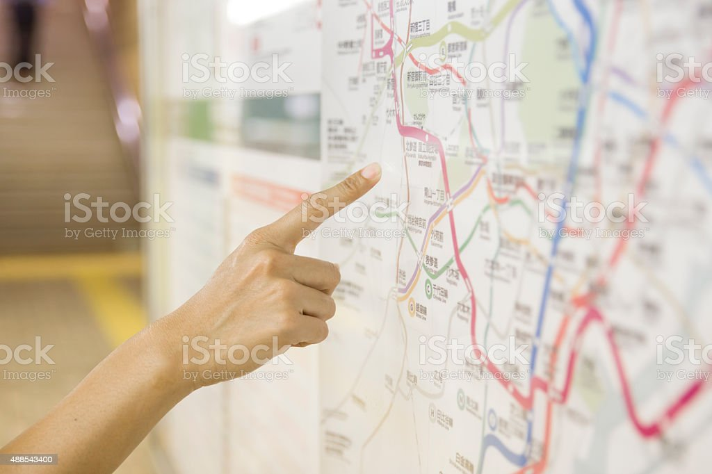 tourist pointing the touritst attraction on a map public stock photo