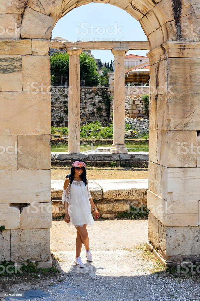 Tourist posing at ancient Greek Ruins in Athens, Greece stock photo