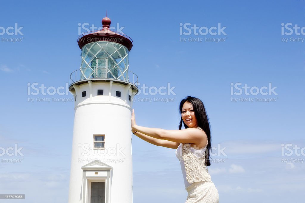 Tourist Posing Snapshot with Lighthouse in Kauai Hawaii stock photo