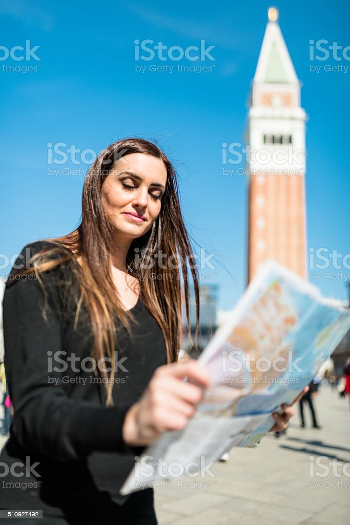 tourist reading a map in Venice stock photo