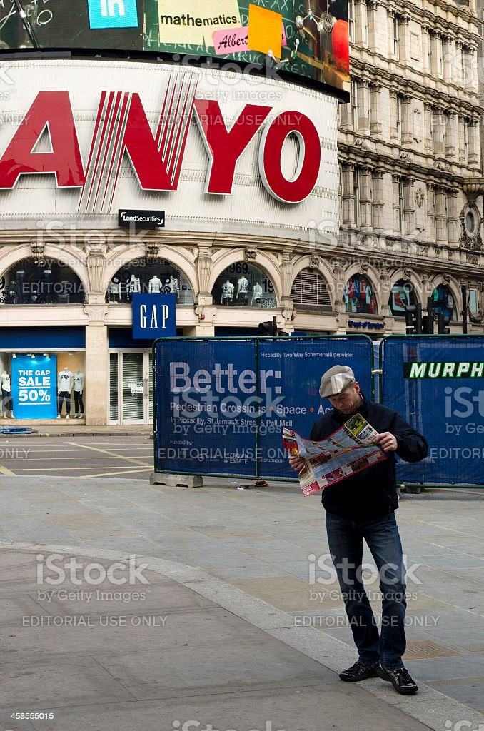 Tourist reading map, Piccadilly Circus, London royalty-free stock photo