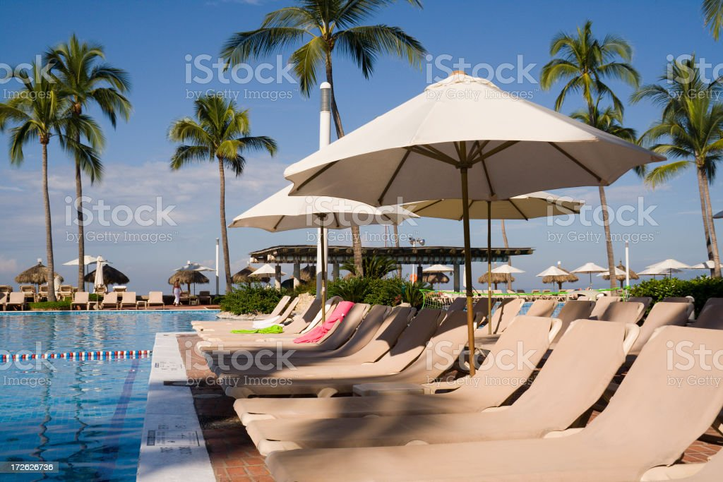Tourist Resort Hotel Swimming Pool and Beach Chairs in Mexico stock photo