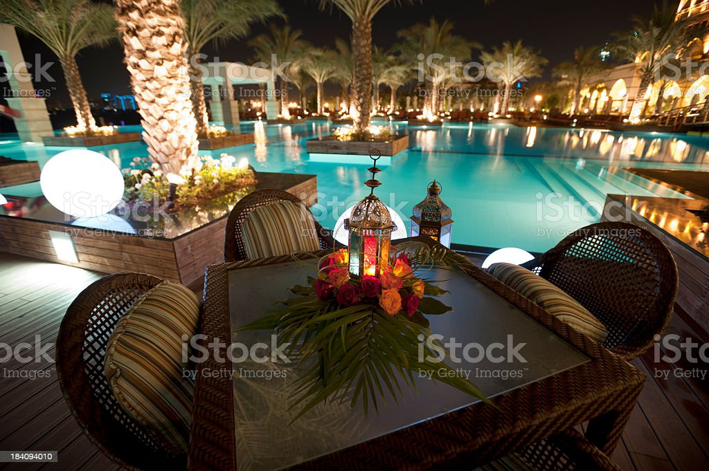 Tourist resort pool at night stock photo