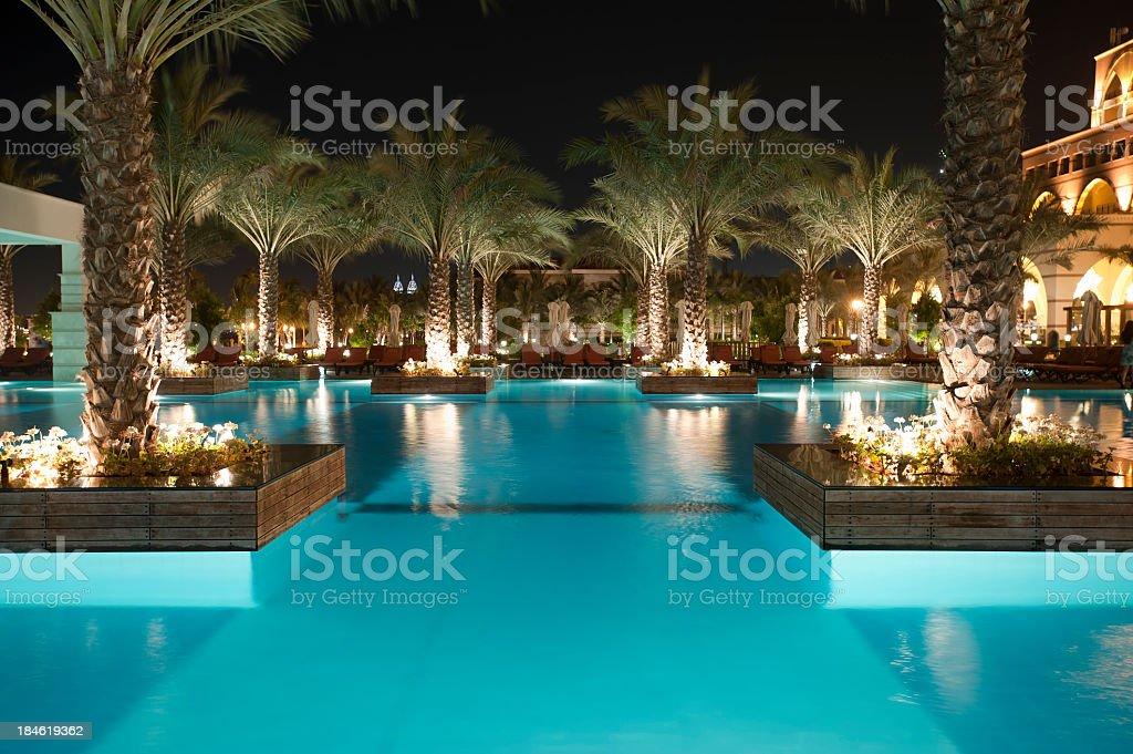 Tourist resort pool at night stock photo