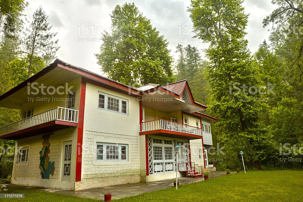 Tourist Rest House in midst of thick forest, Kashmir HDR stock photo