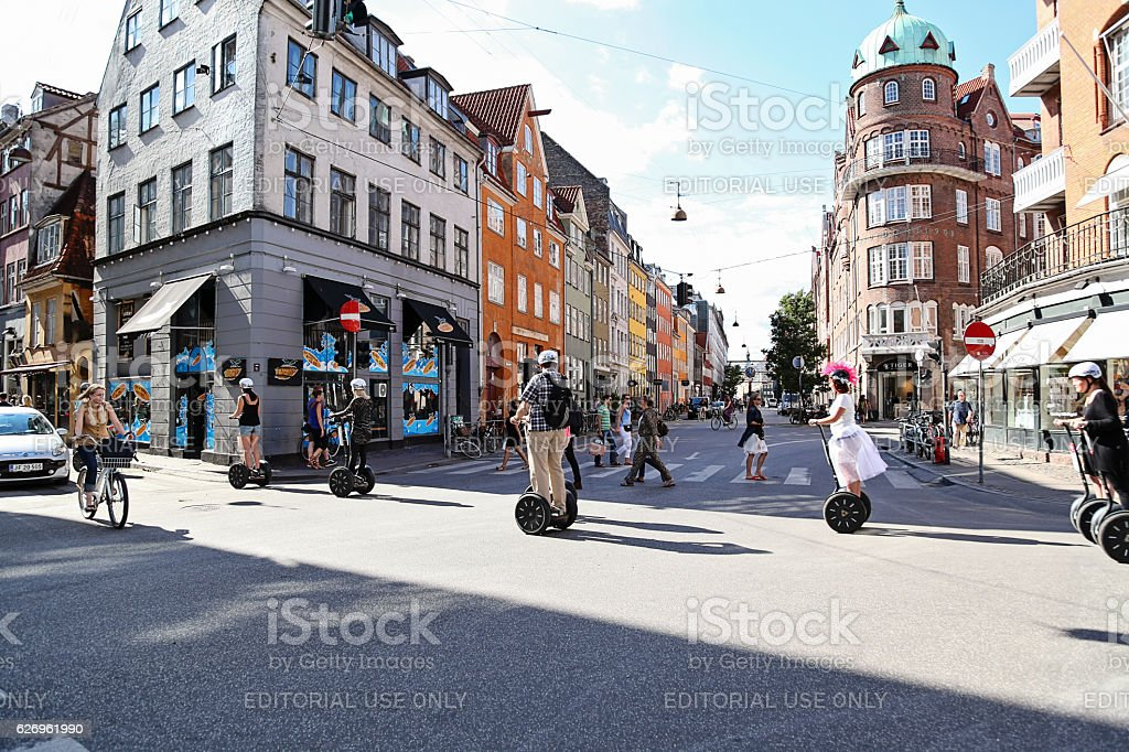 Tourist riding a hoverboard with handles in Copenhagen stock photo