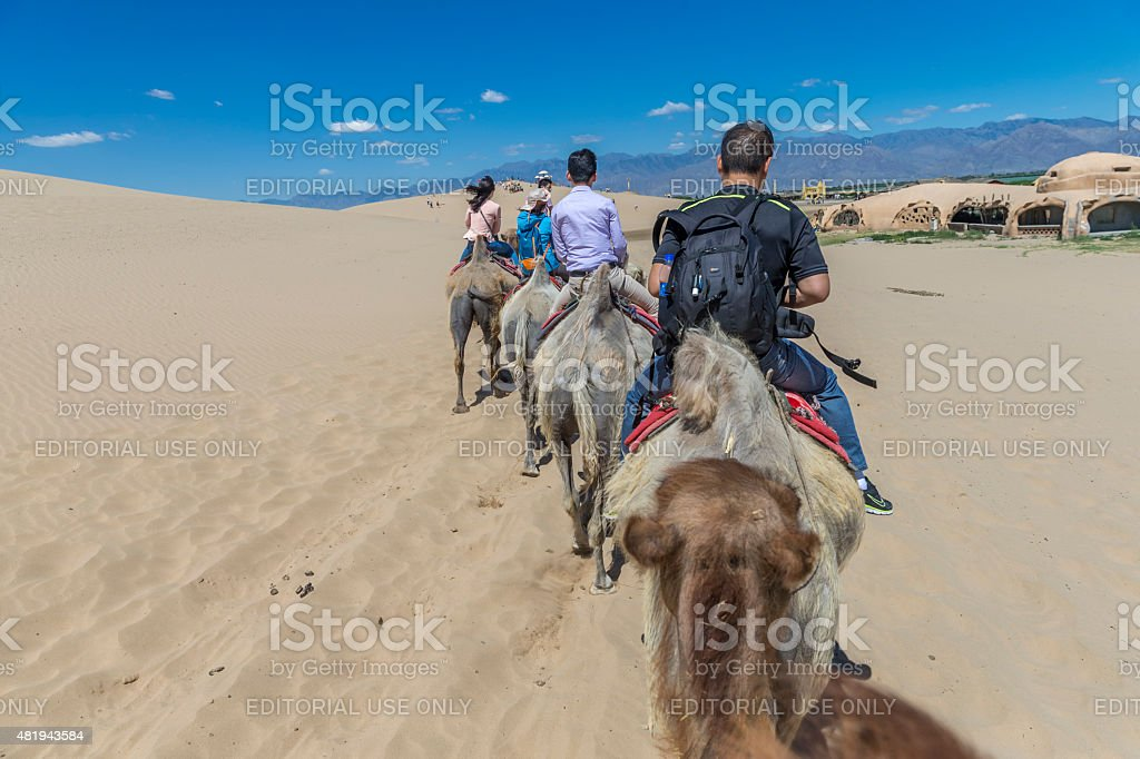 Tourist riding on Camels at the desert, Ningxia, China stock photo