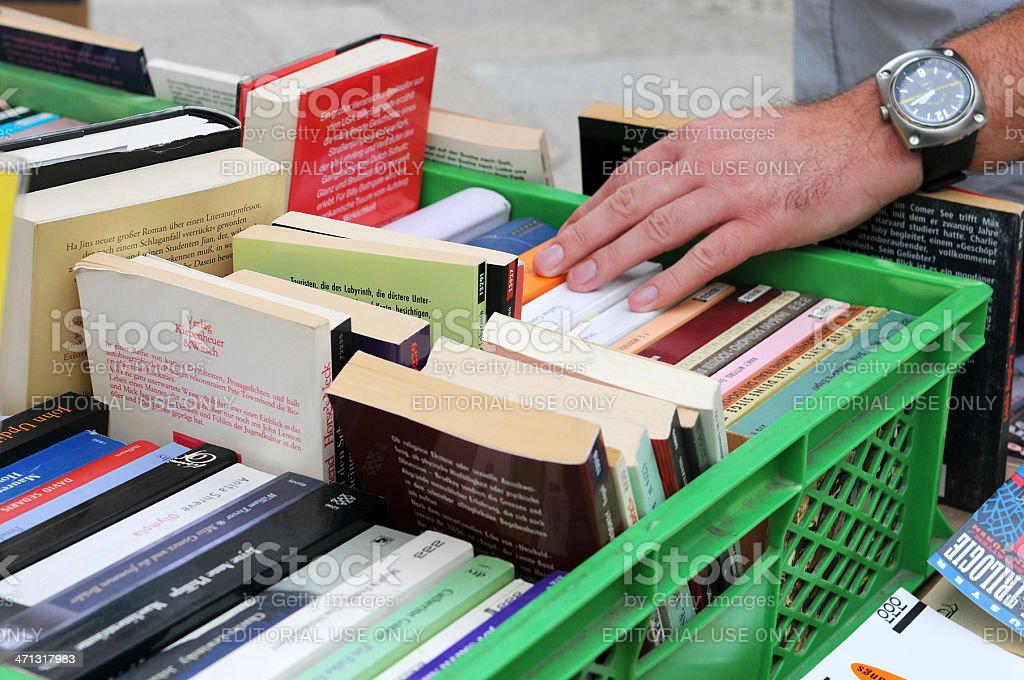 tourist searching in a used bookstore at Berlin Kreuzberg (Germany) stock photo