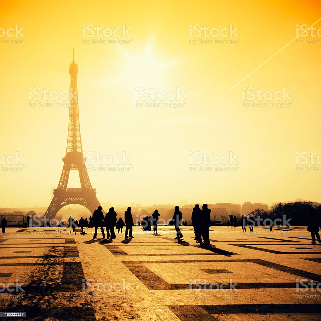 Tourist silhouette in front of Tour Eiffel view against sun royalty-free stock photo