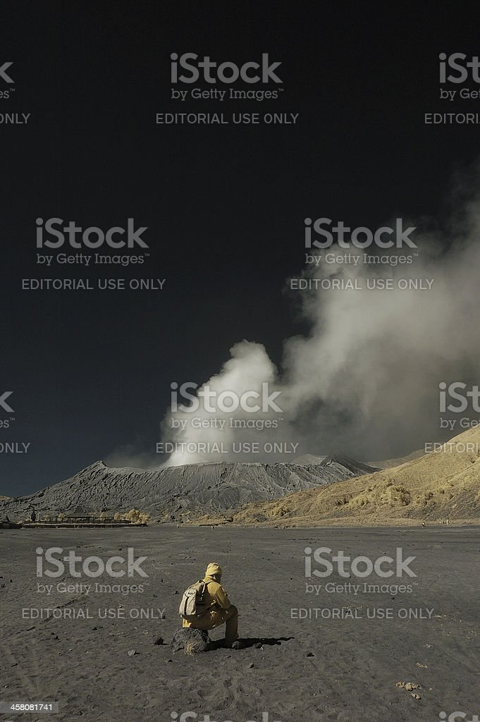Tourist sit down in front of Bromo Mountain stock photo