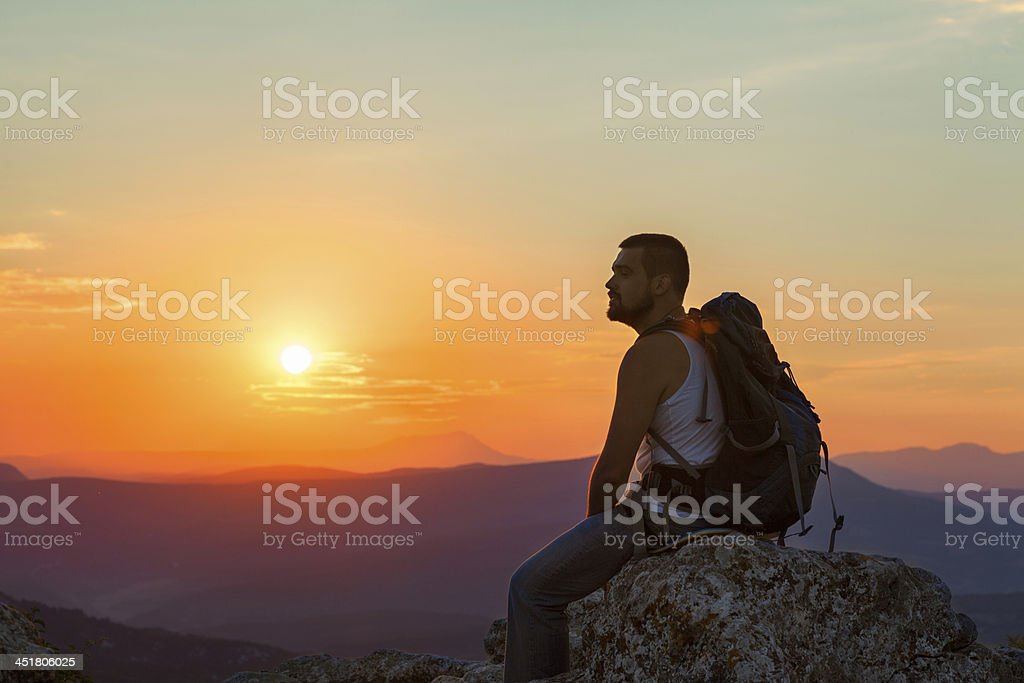 tourist sits in the mountains royalty-free stock photo