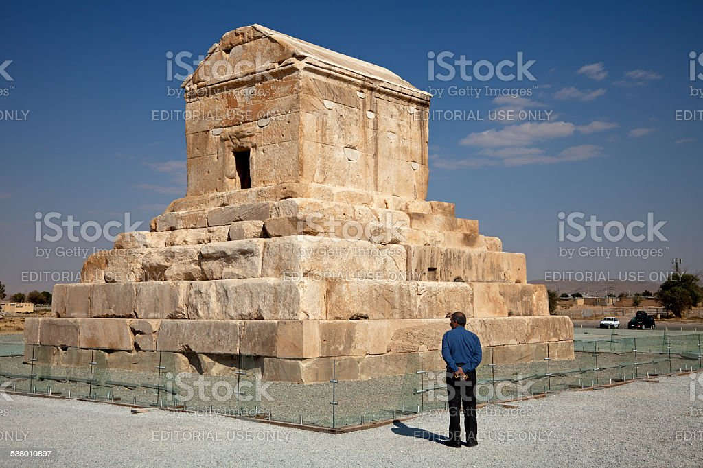 Tourist Standing Beside Cyrus Tomb in Pasargad of Iran stock photo