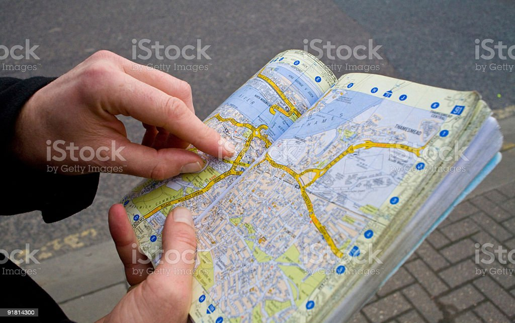 Tourist studying  map stock photo