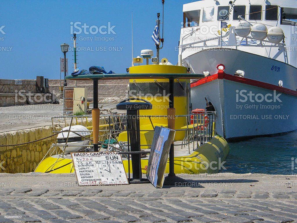 Tourist submarine and boat trip at a quayside. stock photo
