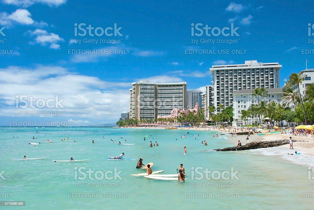 Tourist sunbathing and surfing on the Waikiki beach in Hawaii. royalty-free stock photo