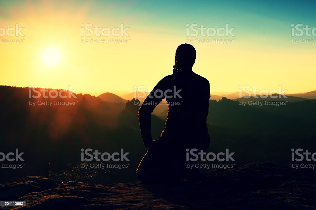 Tourist take a rest. Handsome young man sitting stock photo