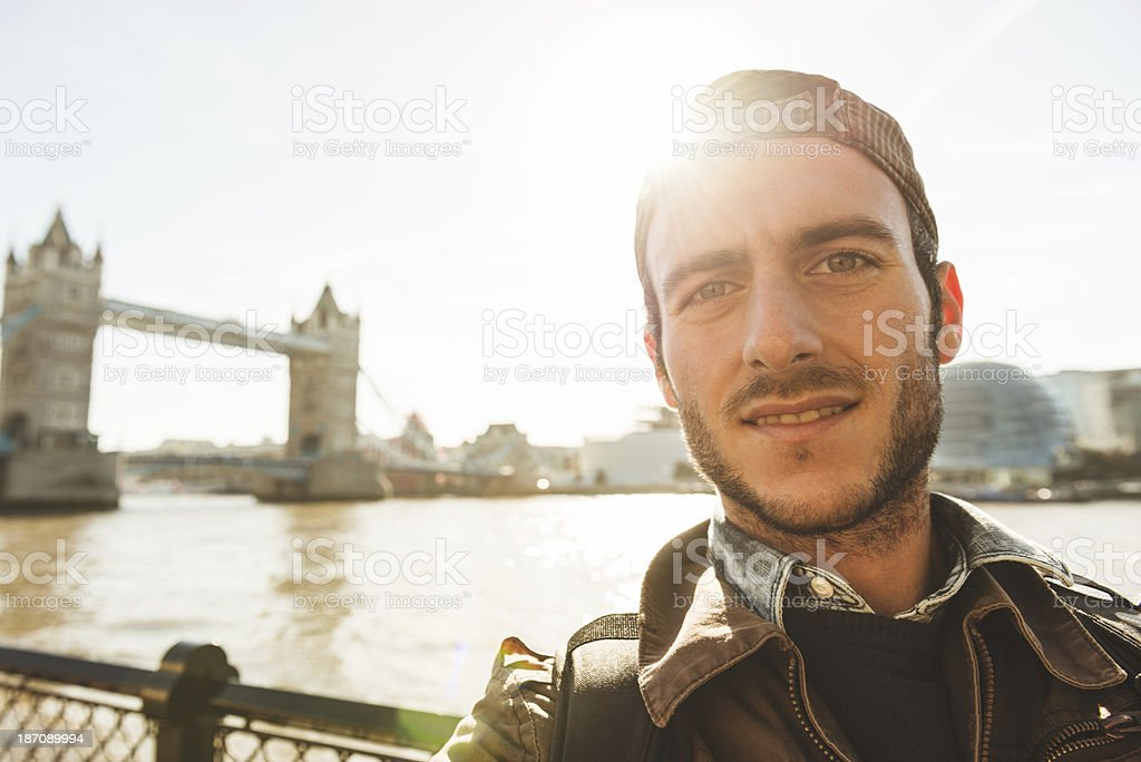 Tourist take a self portrait against Tower bridge in London royalty-free stock photo