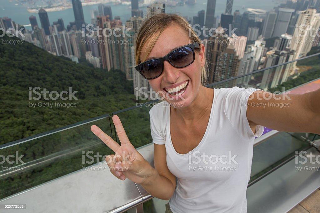 Tourist take selfie in Hong Kong stock photo