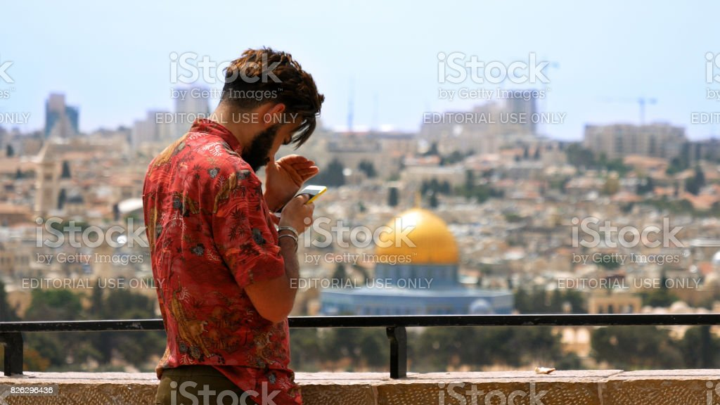 Tourist takes a photo against Jerusalem City view stock photo