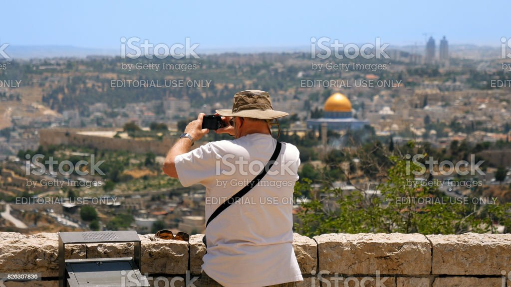 Tourist takes a photo of Jerusalem Old City view stock photo
