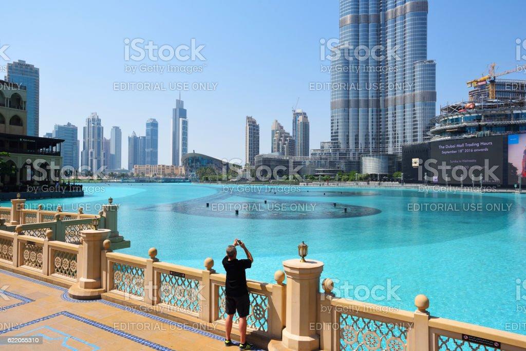 tourist takes a picture of the Burj Khalifa stock photo