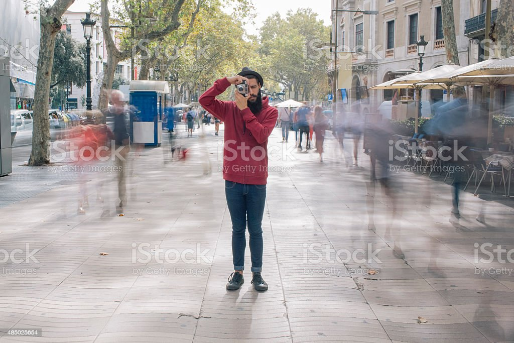 Tourist taking a photo in the city stock photo