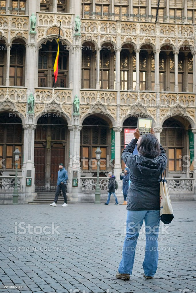 Tourist taking a picture with an iPad in Brussels stock photo