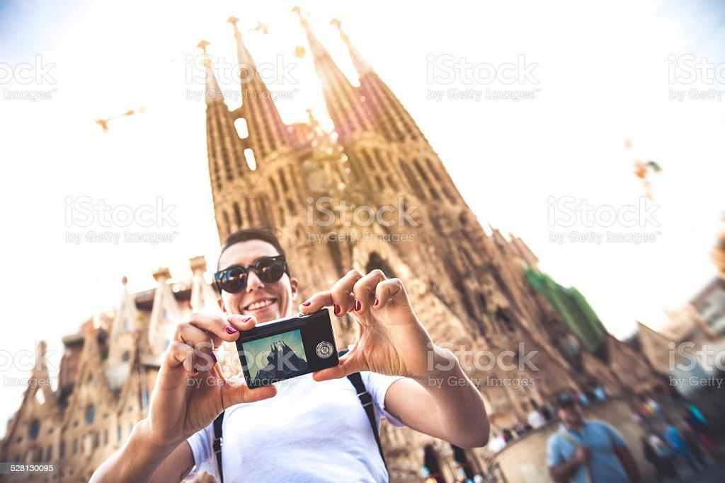 Tourist taking a selfie in front of Sagrada Familia stock photo