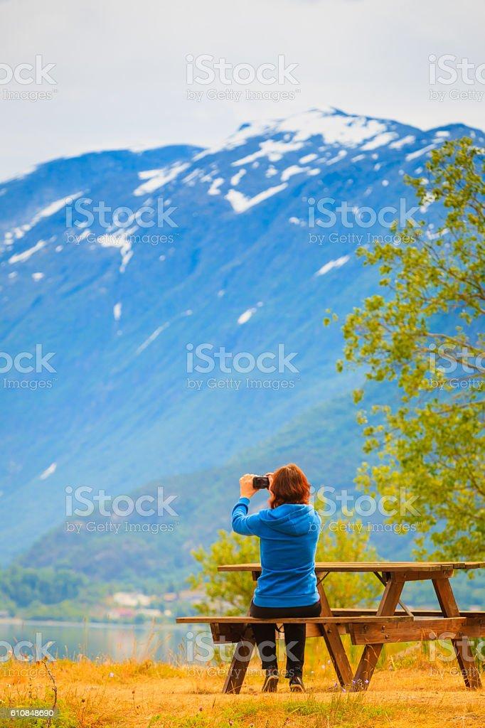 Tourist taking photo at norwegian fjord stock photo