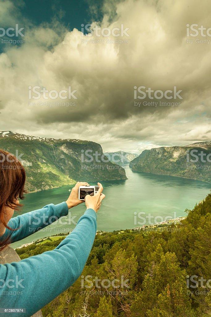 Tourist taking photo from Stegastein viewpoint Norway stock photo