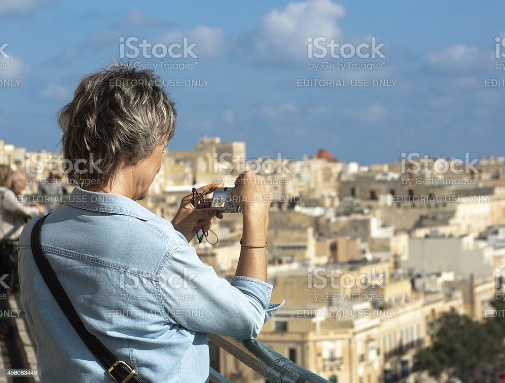 Tourist Taking Photo In Valletta royalty-free stock photo