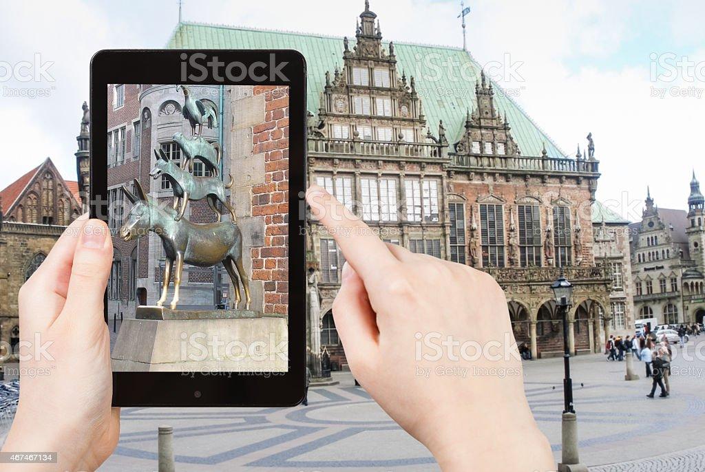 tourist taking photo of Bremen Town Musicians stock photo