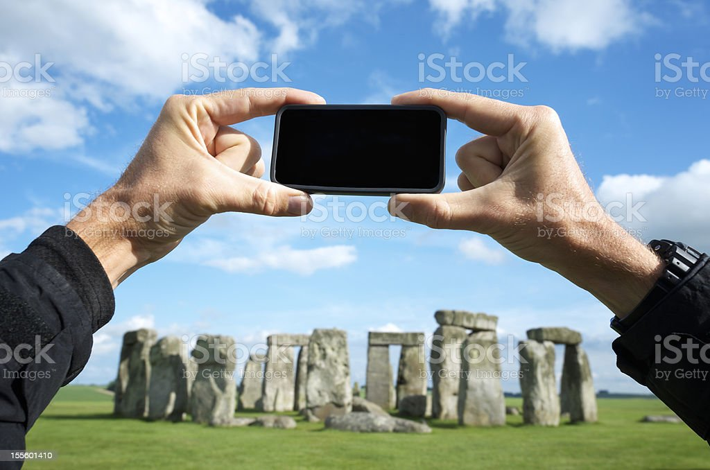 Tourist Taking Photograph of Stonehenge with Camera Phone stock photo