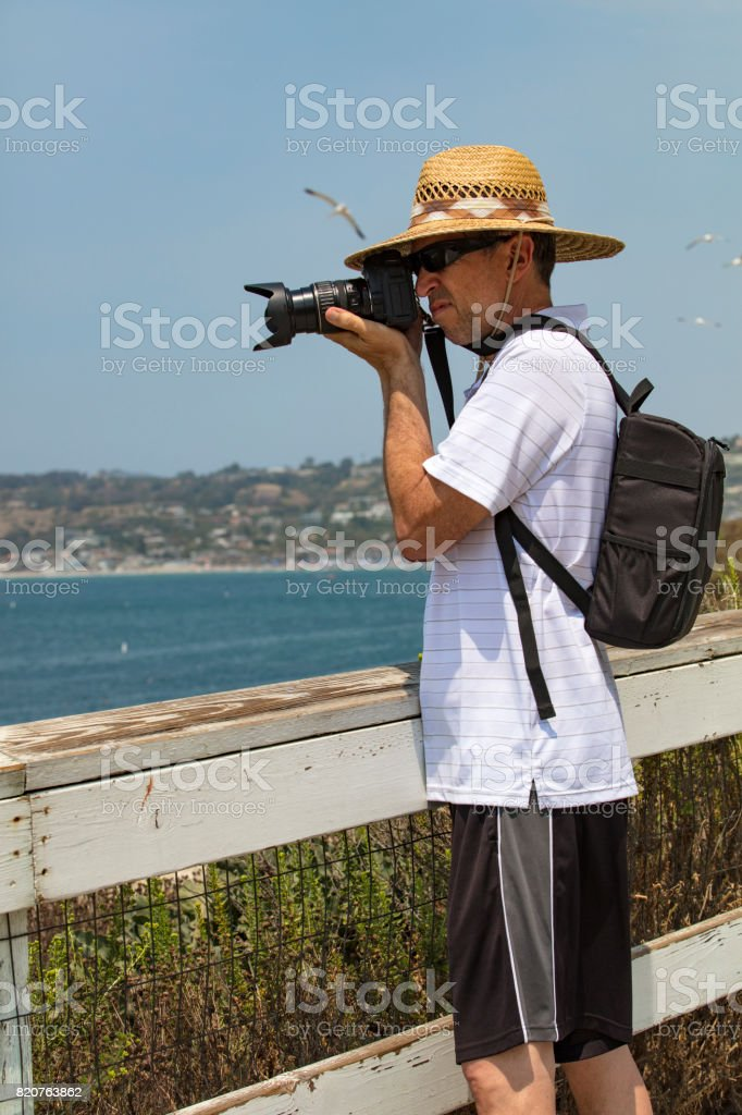 Tourist taking photographs of nature and landscapes stock photo