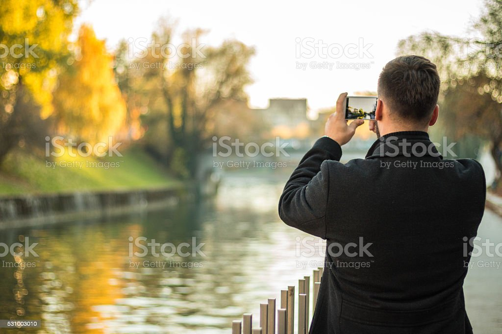 Tourist taking picture of the city stock photo