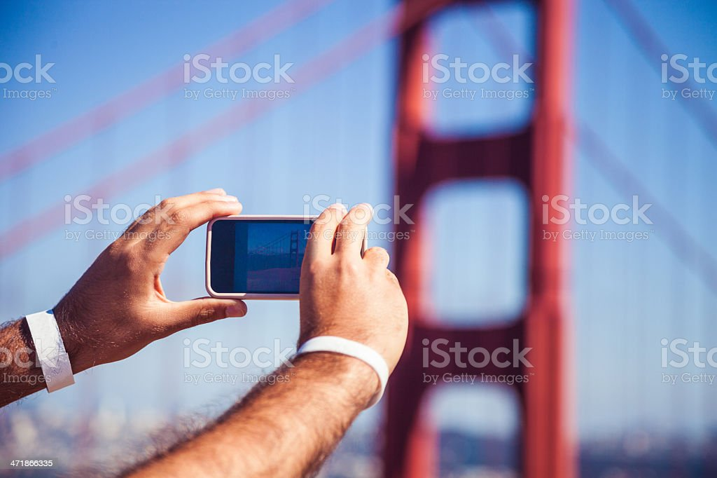 Tourist taking picture to the Golden Gate Bridge royalty-free stock photo