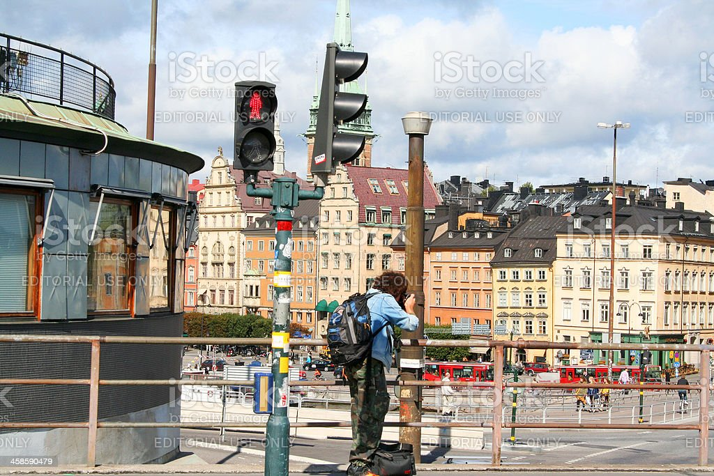 Tourist taking pictures of old city (Gamla Sta'n) Stockholm, Sweden. royalty-free stock photo